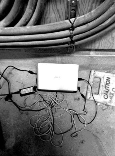 A laptop that was hidden under a box in a wiring closet.